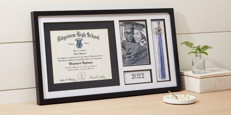 Grad holding Jostens class graduation keepsakes