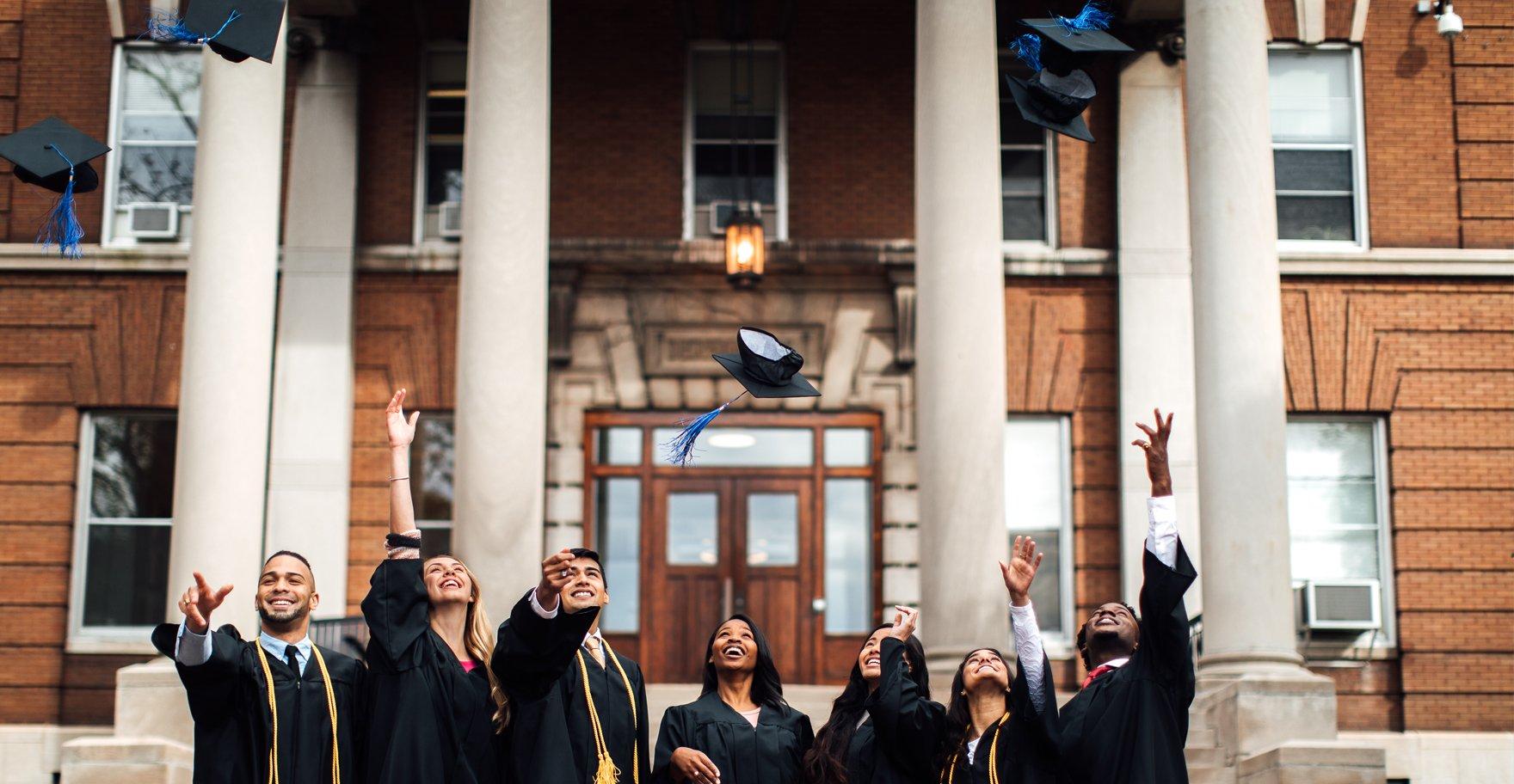 College Graduates celebrating graduation