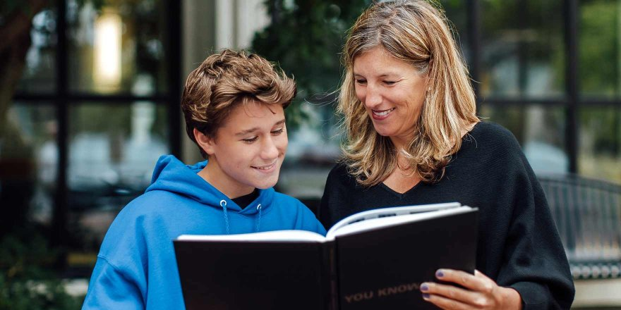 Mom and son looking at yearbook