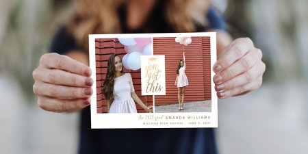 Graduate holding Jostens personalize photo card